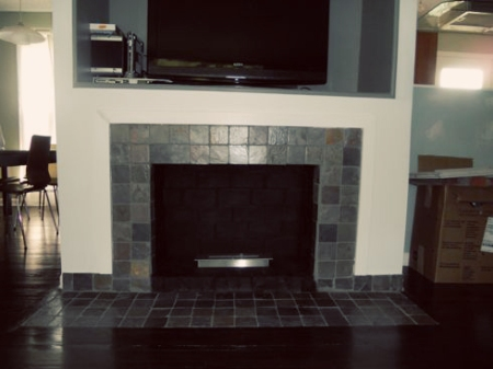 Fireplace makeover removing a brick hearth and retiling mymcmlife
